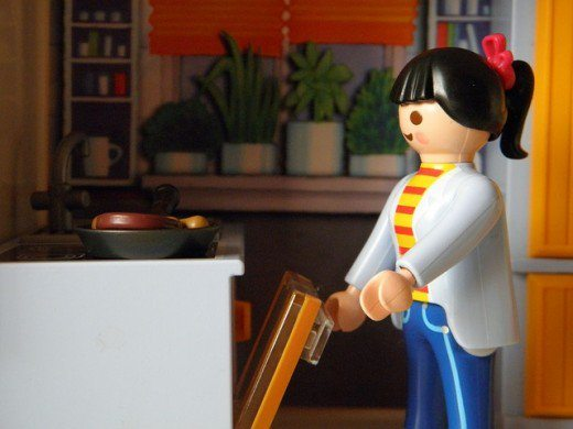 female lego minifigure unloading dishwasher