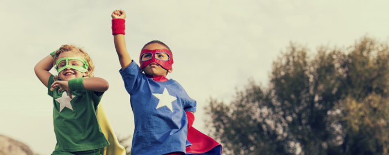 kids in super hero costumes showing confidence